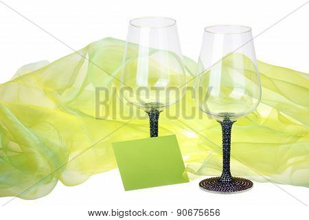 Close-up of two wine glasses with wish card