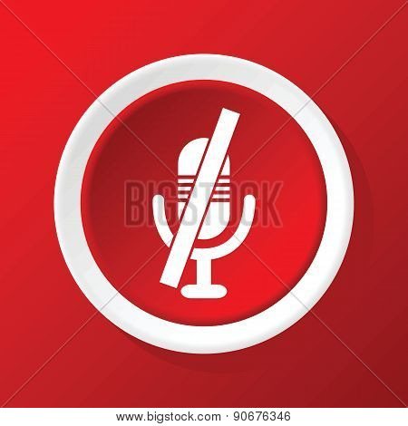 Muted microphone icon on red