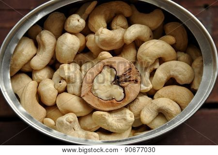Cashew Nuts With A Walnut In A Jar