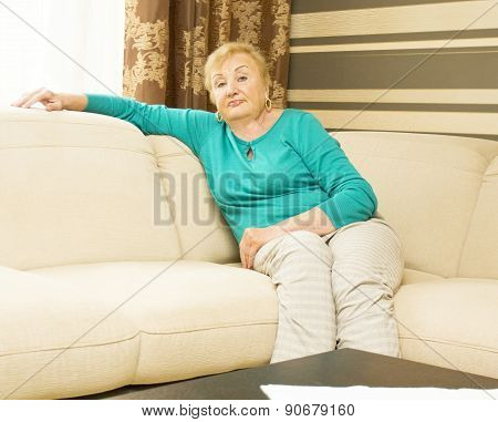 Woman In Ages Sitting On Sofa