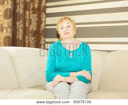 Woman In Ages On Sofa