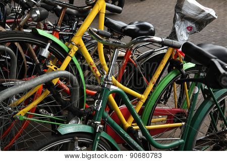 AMSTERDAM, NETHERLANDS - AUGUST 9, 2012: Colourful bicycles parked at the bicycle parking station next to the Central railway station in Amsterdam, Netherlands.