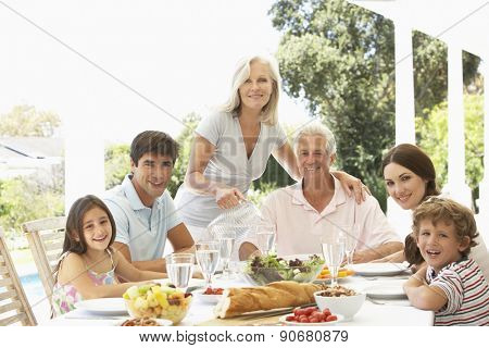 Three Generation Family Enjoying Meal Outdoors