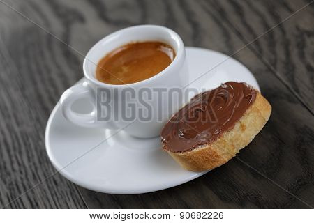 cup of coffee with baguette and chocolate spread