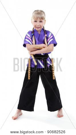 Little girl in kimono with nunchaku isolated on white