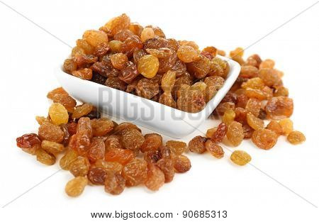 Raisins in saucer isolated on white