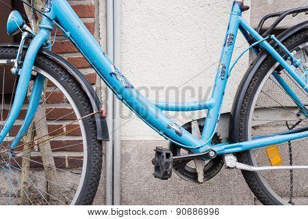 Blue Bike Against Wall