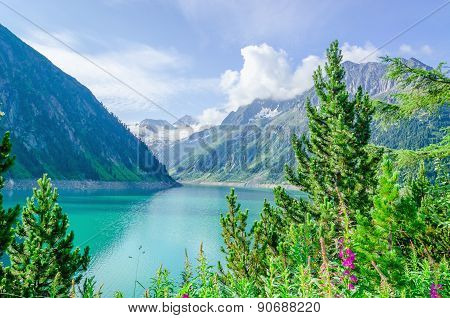 Azure mountain lake and high Alpine peaks, Austria