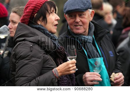 PRAGUE, CZECH REPUBLIC - NOVEMBER 11, 2012: Elderly couple tastes young wine during the celebration of Saint Martin Day in Prague, Czech Republic.