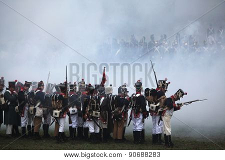 TVAROZNA, CZECH REPUBLIC - DECEMBER 3, 2011: Re-enactors uniformed as French soldiers attend the re-enactment of the Battle of Austerlitz (1805) near Tvarozna, Czech Republic.