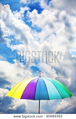 Colorful umbrella on sky background