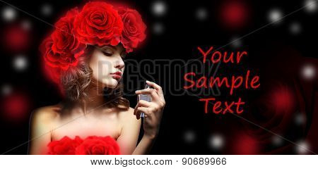 Beautiful woman with perfume bottle on dark background