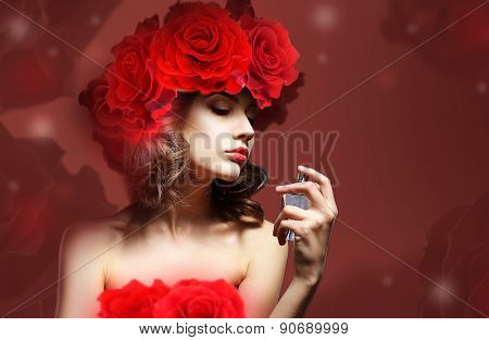 Beautiful woman with perfume bottle on red background