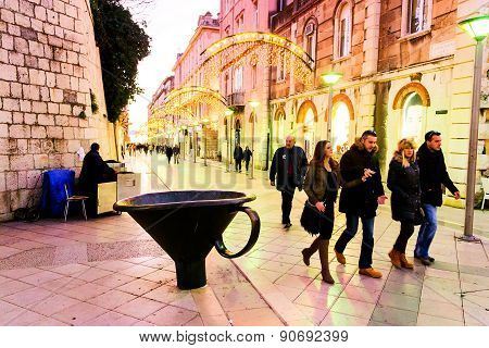 Split, Croatia - January 1: Tourists And Citizens Walking Along One Of The Main Streets In The Old T