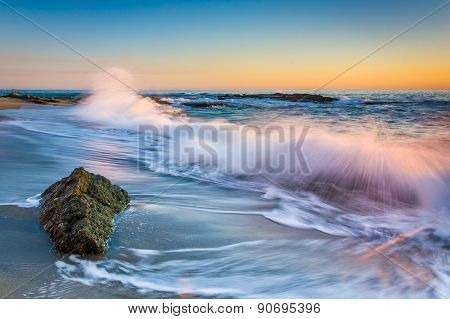 Waves Crashing On Rocks At Sunset, At Victoria Beach, Laguna Beach, California.