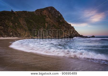 Waves In The Pacific Ocean And A Rocky Bluff At Pfeiffer Beach, In Big Sur, California.
