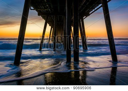 Waves Under The Fishing Pier At Sunset, In Imperial Beach, California.