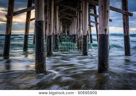 Waves Under The Pier, In Newport Beach, California.