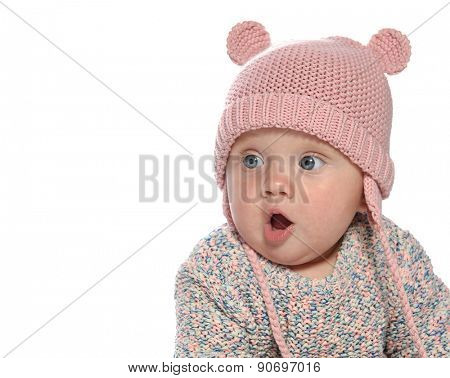 baby girl child  pink fashion portrait face studio shot isolated on white caucasian  hat warm clothing
