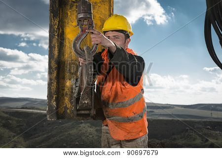 Manual Worker of Drilling Machine