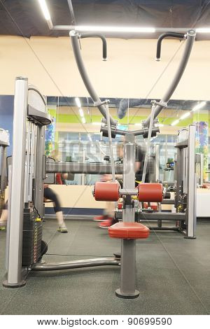 Modern interior of a fitness club gym with sport equipment modern interior