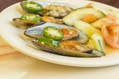 image of cucumber slice  - Spicy chili mussels with jalapeno slices and cucumber tomato salad - JPG