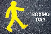 picture of boxing day  - Yellow pedestrian figure on the road walking towards BOXING DAY - JPG
