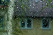 stock photo of raindrops  - Raindrops on the window with blurred background - JPG