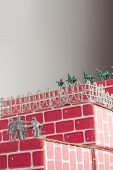 stock photo of underdog  - Gray toy army men up against impossible odds in uphill battle - JPG