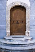 image of stepping stones  - Architectural Exterior Detail of Closed Arched Wooden Door of Building Constructed from Blue Stone Marble with Steps - JPG