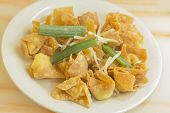 stock photo of chinese restaurant  - Chinese cheese wontons appetizer at restaurant served with green onion and bean sprouts - JPG