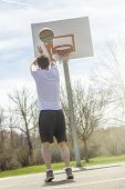 pic of early 20s  - Young man shooting free throws from the foul line - JPG