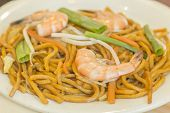 foto of chinese wok  - Authentic Chinese Shrimp lo mein noodles at a restaurant - JPG