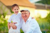 image of grandpa  - portrait of happy grandpa and grandson embracing outdoors - JPG