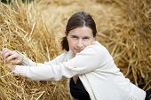 pic of blouse  - Pretty young woman in a white blouse posing on a straw background - JPG