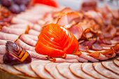 image of smoked ham  - Choice of smoked ham and sausages on the table - JPG