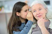 foto of grandma  - Little girl and grandma whispering secrets - JPG