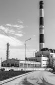 foto of belching  - Work building with a large chimney in black and white - JPG