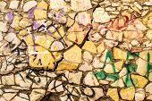 foto of derelict  - Aged and derelict brick wall in color with graffiti and cracks - JPG