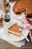 foto of cheesecake  - A Slice of Spiced Coffee Cheesecake Dusted with Cocoa Powder copy space for your text - JPG
