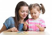 pic of girl toy  - child girl and mother playing together with puzzle toy - JPG