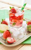 stock photo of sangria  - Homemade strawberry lemonade or sangria with fresh lime - JPG