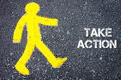 picture of pedestrians  - Yellow pedestrian figure on the road walking towards TAKE ACTION - JPG
