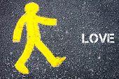 foto of pedestrians  - Yellow pedestrian figure on the road walking towards LOVE - JPG