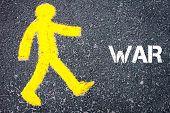 picture of pedestrians  - Yellow pedestrian figure on the road walking towards WAR - JPG