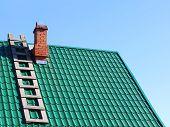 image of tile  - Wooden ladder on mint color tiled roof taken closeup - JPG