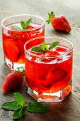 stock photo of cold drink  - Cold strawberry drink with strawberry slices and mint - JPG