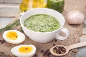 image of pesto sauce  - sauce of pesto near a pepper olive oil and eggs in a studio - JPG