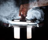 pic of gourmet food  - hand of chef open hot stream pot with beautiful studio lighting against black background use for people cooking food and water boiled in kitchen room - JPG