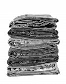 stock photo of denim jeans  - Stack of Black denim jean on white background - JPG